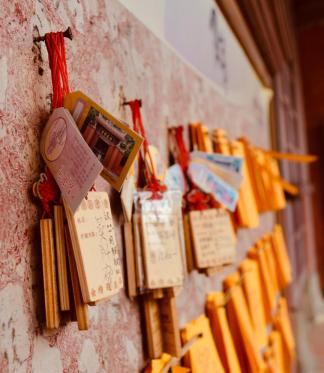Ema, small paper or wooden plaques, in which Buddhist worshippers write prayers or wishes. The ema are left hanging up at the shrine, where the kami (spirits or gods) are believed to receive them.
